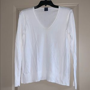 White sweater. No stains